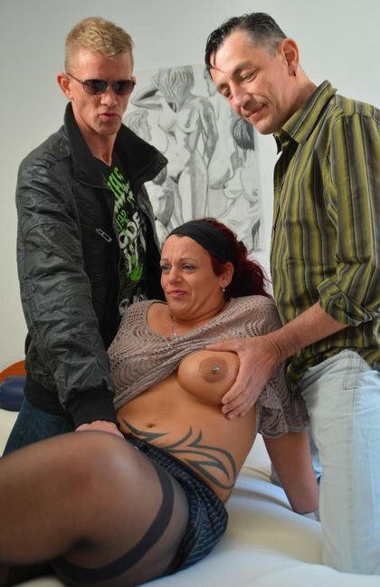 Mature German redhead takes heavy plowing and facial in swinger threesome