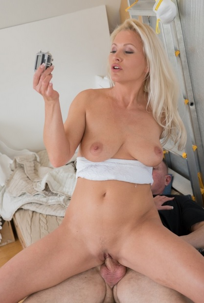 Sultry blonde Czech MILF Kathy Anderson gets cum on pussy from photographer