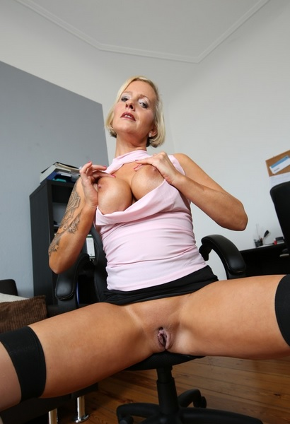 German blonde big-titted MILF boss fucks two guys at the office
