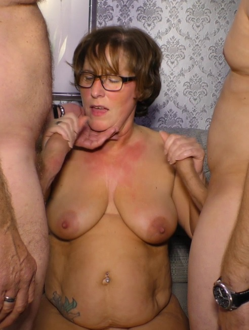 Naughty German mature lady enjoys two hard cocks