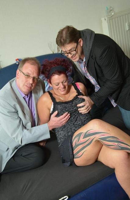 Tattooed German redhead tastes two cocks in steamy MMF threesome
