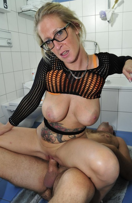 Big titted German blondie with glasses fucks in the bathroom