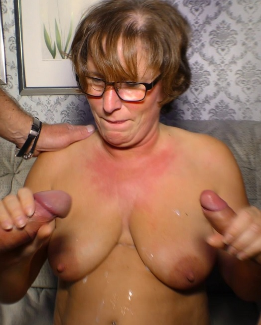Naughty German mature lady enjoys two hard cocks in raunchy MMF threesome