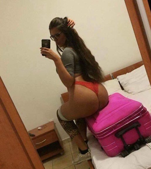 Selfie In Red Thong
